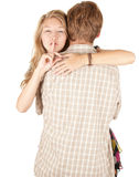 Young couple, girl with finger on mouth Stock Photo