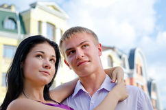 Young couple with the girl holding her partner Stock Photography