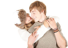 Young couple, girl kissing her boyfriend Royalty Free Stock Photo
