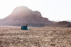 Young couple girls camping desert tent morning mountain waving hello Stock Images