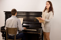 Young couple giving a classical duet Stock Photography