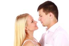 Young couple giving you a warm smile Stock Photos