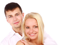 Young couple giving you a warm smile. Portrait of a young couple giving you a warm smile on white background Stock Images