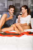 A young couple with a glass of wine in an asian style hotel room Stock Photography