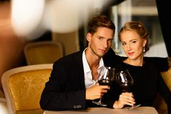 Young couple with glasses of wine Royalty Free Stock Photography