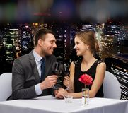 Young couple with glasses of wine at restaurant Royalty Free Stock Photos