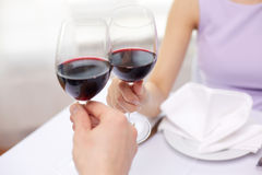 Young couple with glasses of wine at restaurant Stock Photo
