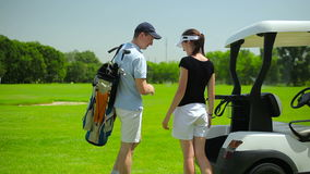 Young couple go to play golf stock footage