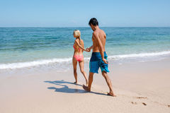 Free Young Couple Going For Swim In Sea Stock Photos - 76787673