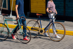 Young couple going for a summer bicycle ride Royalty Free Stock Image