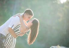 Young couple going to kiss outdoors Stock Images