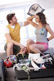 Young couple going to summer vacation packing bag Stock Image