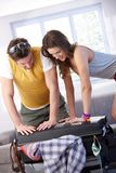 Young couple going to summer vacation packing bag royalty free stock images