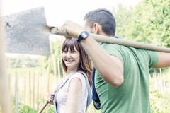 Young couple go to work in your garden. Young couple going to work in the early morning in your garden with shovel Royalty Free Stock Photos