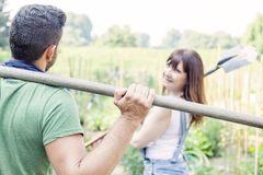 Young couple go to work in your garden. Young couple going to work in the early morning in your garden with shovel Royalty Free Stock Images