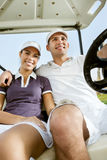 Young couple on golf Stock Photo