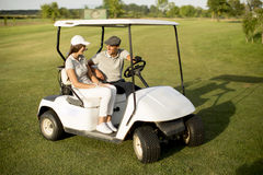 Young couple at golf cart Stock Images
