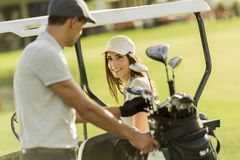 Young couple at golf cart Royalty Free Stock Images