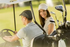Young couple at golf cart Stock Photo