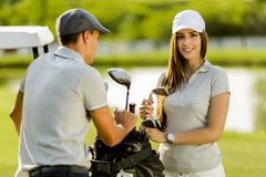 Young couple at golf cart Royalty Free Stock Image