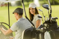Young couple at golf cart Royalty Free Stock Photos