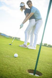 Young couple on golf course Royalty Free Stock Image