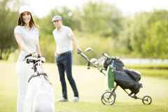Young couple at golf course Royalty Free Stock Photos