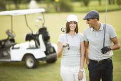 Young couple at golf course. Young couple playing at golf course Stock Image