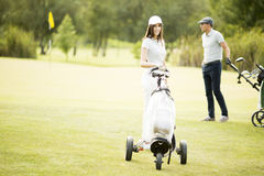 Young couple at golf course Stock Images