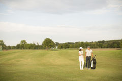 Young couple at golf course Royalty Free Stock Image