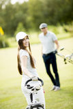 Young couple at golf course Royalty Free Stock Photography