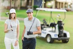 Young couple at golf Royalty Free Stock Image