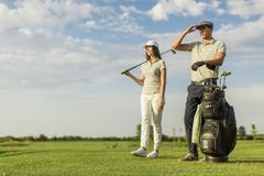Young couple at golf Stock Images
