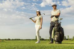 Young couple at golf Royalty Free Stock Photo