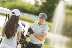 Young couple at golf court Royalty Free Stock Photography