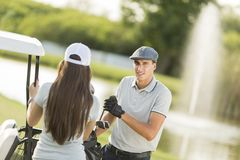 Young couple at golf court Stock Photo