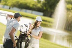 Young couple at golf court Stock Photos