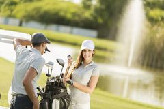 Young couple at golf court Royalty Free Stock Images