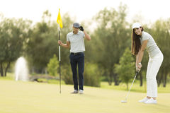 Young couple at golf court Stock Photography