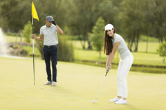 Young couple at golf court Stock Image
