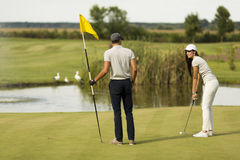 Young couple at golf court Royalty Free Stock Image