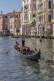 Young couple on a Gondola, Grand Canal, Venice, Italy. Europe royalty free stock image