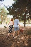 A young couple got out of town for a walk in the woods. The concept of active rest stock photo