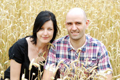 Young couple in a grain field Stock Image
