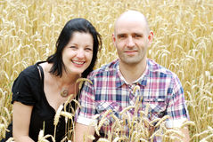 Young couple in a grain field Stock Photos