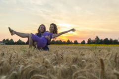Young couple at grain field Stock Images