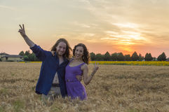 Young couple at grain field Stock Photo