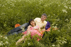 Young couple on grass Stock Images