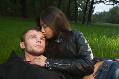 Young couple on a grass Stock Photos