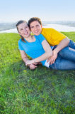 Young couple on the grass Stock Photography
